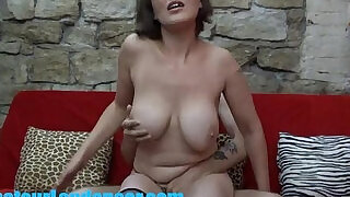 Busty MILF gives lapdance and handjob to kinky guy