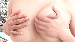 Milk covered HInano fondles her big tits and toys her pussy