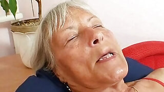 Ugly grandma Cecilie toys her hairy wet pussy